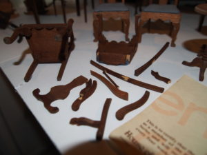 Broken miniature furniture in need of repair