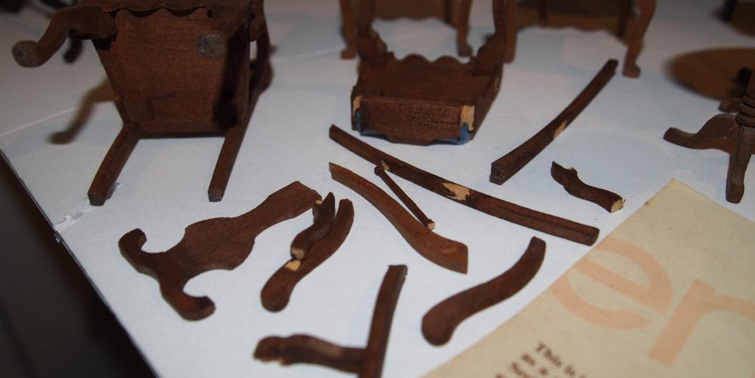 Broken miniature furniture in need of repair